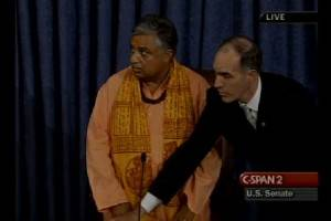 Rajan Zed waits as protesters interrupt the invocation. Photo courtesy of C-Span 2.