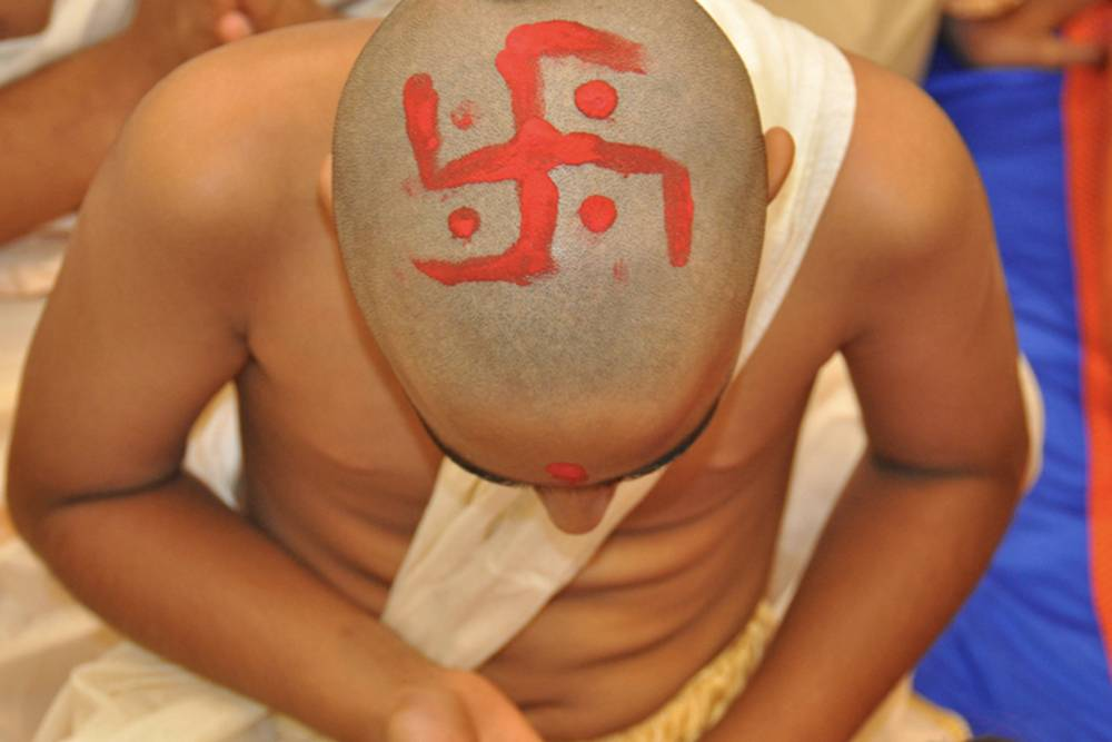 boy with a swastika painted on his shaved head